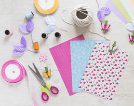 pink and purple scrapbooking supplies and envelope