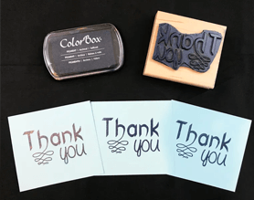 Wood handle rubber stamp with thank you impressions