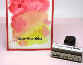 Happy everything watercolor craft card with a traditional wood handle stamp